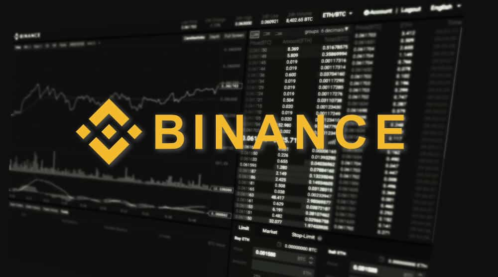 Binance logo over their trading interface